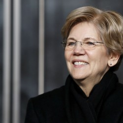 Sen. Elizabeth Warren, D-Massachusetts, listens to remarks at the dedication ceremony for the Edward M. Kennedy Institute for the United States Senate, in Boston, March 30, 2015.