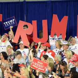 Supporters of Republican presidential candidate Donald Trump cheer during a campaign rally at the Charlotte Convention Center in Charlotte, North Carolina, Oct. 14, 2016.