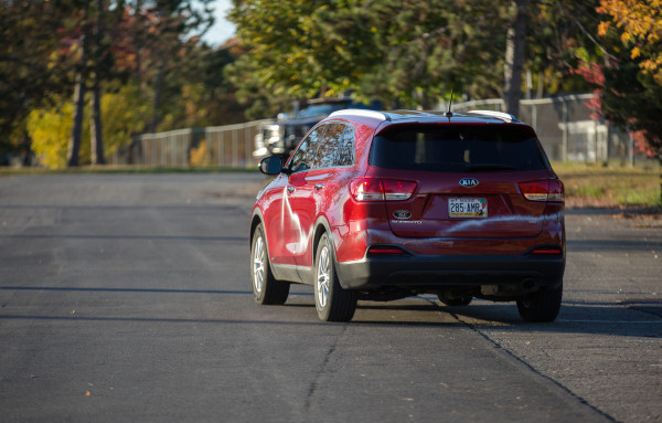 A car vandalized with spray paint during a rally for Republican presidential nominee Donald Trump pulls out of the Cross Insurance Center parking lot after the rally on Saturday afternoon.