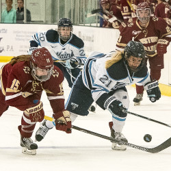Tereza Vanisova (right) of the University of Maine battles for the puck with Boston College's Erin Connolly during Saturday night's game at the Norway Savings Bank Arena in Auburn.