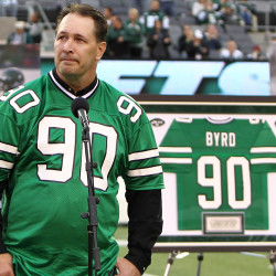Former New York Jets player Dennis Byrd reacts after his number is retired during a half-time ceremony on Oct. 28, 2013. Byrd died Saturday in a car crash in Oklahoma.