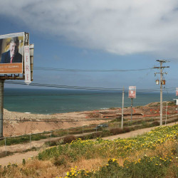 A billboard about 10 miles south of the U.S. border advertises the Trump Ocean Resort Baja. A developer of the Tijuana, Mexico, resort agreed to pay $7.25 million to settle a lawsuit brought by 190 buyers who lost $22 million in deposits after the project failed in 2008.