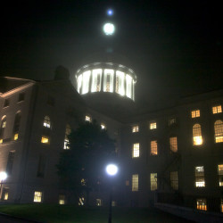 The State House shines through the the fog on June 16, 2015.