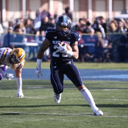 Darian Davis-Ray of the University of Maine runs through a big hole during Saturday's Colonial Athletic Association football game against Albany at Alfond Stadium in Orono. The sophomore is among three running backs who are sharing the ballcarrying load for the Black Bears.