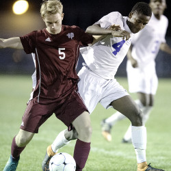 Colin Waterman, left, of Bangor and Yusuf Mohamed of Lewiston High School compete for control of the ball during the first half in Lewiston on Monday.