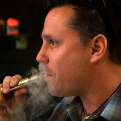 John Kreis, co-owner of the Old Port Vape Shop, enjoys a hit from a personal vaporizer, June 6, 2014.