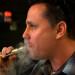 John Kreis, co-owner of the Old Port Vape Shop, enjoys a hit from a personal vaporizer, June 6, 2014.