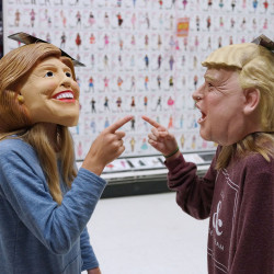 Kids play with masks of presidential candidates Hillary Clinton and Donald Trump inside a Halloween and costume shop on Oct. 10, 2016, in Washington, D.C.