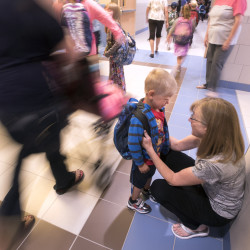Caryle Janicki, a special education teacher at the new Central Community Elementary School, talks to 3-year-old Noah Werenko to help him find the pre-kindergarten classroom on the first day of school in Corinth, Aug. 31, 2016.