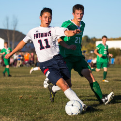 Bangor Christian School's Erik Gorczok (left) takes control of the ball from Schenck's  Dylan Danforth during their soccer game at Bangor Christian School on Monday.
