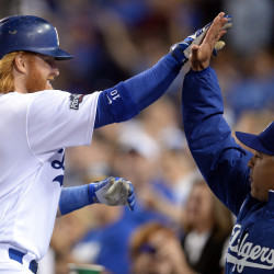 Los Angeles third baseman Justin Turner (10) celebrates with Dodgers manager Dave Roberts (30) after hitting a solo home run during the sixth inning against the Chicago Cubs in game three of the 2016 NLCS playoff baseball series at Dodger Stadium. The Dodgers won 6-0.