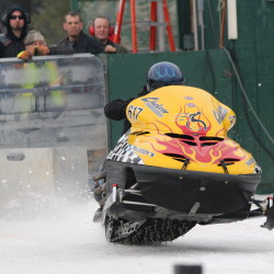 Mike Moulton of China, Maine, accelerates on the Medway ice dragway on Jan. 18, 2014, during the qualifying races for the Northeast Winter Nationals Snowmobile Ice Drag Races.