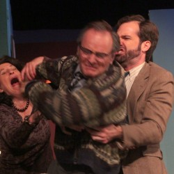 "Bryan Lescord (right) as Nick tries to separate Cindy Robbins (left) as Martha and Tim Pugliese as George in New Surry Theatre's production of ""Who's Afraid of Virginia Woolf?"""