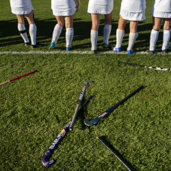Field hockey sticks lay on the ground while the Foxcroft Academy team is announced before the start of their game against Hermon in Dover-Foxcroft Wednesday.