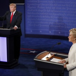 Donald Trump speaks as Hillary Clinton listens during their third and final presidential campaign debate at UNLV in Las Vegas, Nevada, Wednesday.