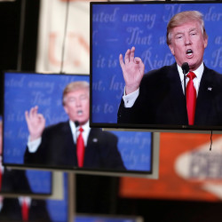 Republican U.S. presidential nominee Donald Trump is shown on TV monitors in the media filing room on the campus of University of Nevada, Las Vegas, during the last 2016 U.S. presidential debate in Las Vegas, Oct. 19, 2016.