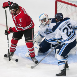 Rensselaer Polytechnic Institute's Brady Wiffen (left) tries for the redirect goal past University of Maine's Rob McGovern (center) and Eric Schurhamer during their hockey game at Alfond Arena in Orono, Oct. 7, 2016.