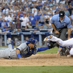 Los Angeles Dodgers first baseman Adrian Gonzalez (23) is tagged out at home plate by Chicago Cubs catcher Willson Contreras (40) in the second inning during game four of the 2016 NLCS playoff baseball series at Dodger Stadium.