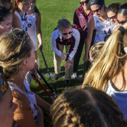 Foxcroft Academy head coach Stephanie Smith (center) amps up her team before their field hockey game against Hermon in Dover-Foxcroft Wednesday.