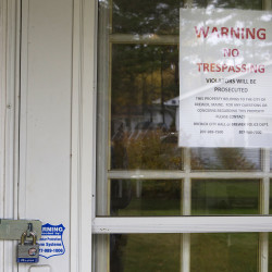A no trespassing sign is seen on a side door of the foreclosed home at 91 Longmeadow Drive in Brewer Thursday. The city of Brewer purchased the property and plans to renovate it and put it back on the market.
