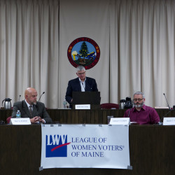 Michael Crowley (center) poses a question during a City Council candidate forum while Andrew Bennett (left), Marc Eastman (second from left), Gibran Graham (second from right) and Daniel Tremble listen on Thursday at Bangor City Hall.