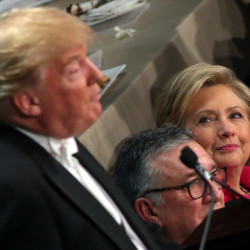 Democratic U.S. presidential nominee Hillary Clinton looks at Republican U.S. presidential nominee Donald Trump as he speaks during the Alfred E. Smith Memorial Foundation dinner in New York, Oct. 20, 2016.