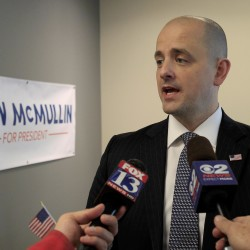 Third-party candidate Evan McMullin, an independent, talks to the press as he campaigns in Salt Lake City, Utah, on Oct. 12.