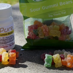 Marijuana-infused sour gummy bear candies (left) are shown next to regular ones at right in a photo illustration near to where they were purchased in Northglenn, Colorado, in this October 2014 file photo.