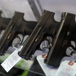 Handguns are seen for sale in a display case at Metro Shooting Supplies in Bridgeton in this November 2014 file photo.