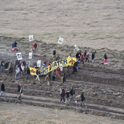 Protesters gather near a pipeline being built by a group of companies led by Energy Transfer Partners LP at a construction site in North Dakota before being confronted by police on Oct. 22, 2016.