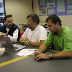 At McMurdo Station, (from left) Eric Steig, Paul Mayewski and Gordon Hamilton discuss preparation for the 2002-2003 International Trans-Atlantic Scientific Expedition. The final year of a four-season project, the team began its six-week to seven-week expedition journey over the West Antarctica Ice Sheet toward the South Pole. International Trans-Atlantic Scientific Expedition, a multi-national, multi-disciplinary program, is geared to produce an improved description and understanding of environmental change in Antarctica over the last 200 years.