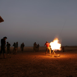 Rebel fighters fire a weapon towards Syria Democratic Forces (SDF) controlled Tell Rifaat town, northern Aleppo province, Syria October 22, 2016.