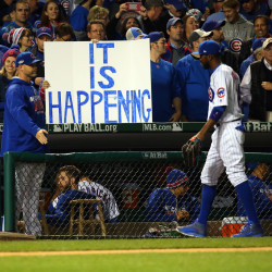 Chicago Cubs fans hold up a sign as center fielder Dexter Fowler (24) walks back to the dugout during the fourth inning of game six of the 2016 NLCS playoff baseball series against the Los Angeles Dodgers at Wrigley Field.