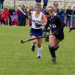 Mt. Blue's Samantha Ellis (left) and Skowhegan's Rylie Mullen race toward the ball in a Class A North field hockey semifinal field hockey game at Caldwell Field in Farmington on Monday.