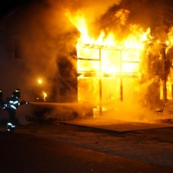 A fire ripped through a two-unit apartment building in Norway, leaving eight people homeless.