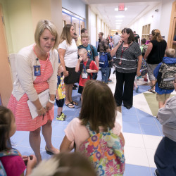 Kerri Wyman (left) assistant principal at the new Central Community Elementary School talks to students about where to find their classroom on the first day of school in Corinth, Aug. 31, 2016.
