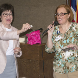 Sen. Susan Collins (left) and Pink Aroostook Project Director Bethany Zell give out door prizes during the Think Beyond Pink luncheon on Monday at the Caribou Inn & Convention Center in Caribou.