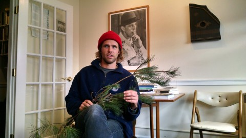 Portland artist Asher Woodworth, 30, poses in his downtown studio on Tuesday, Oct. 25 with evergreen boughs — similar to the ones he wore while standing in traffic in a busy city intersection the day before. Portland police arrested him for blocking traffic. He says he was doing it in the name of art.