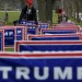 Elam Stoltzfus plants lawn signs outside a U.S. Republican presidential candidate Donald Trump campaign rally in West Allis, Wisconsin, United States, April 3, 2016.