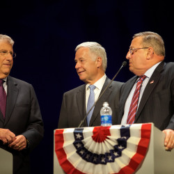 Candidates for governor independent Eliot Cutler (left), Democratic U.S. Rep. Mike Michaud (center) and incumbent Republican Gov. Paul LePage greet each other on stage before a televised debate in Augusta in this October 2014 file photo.