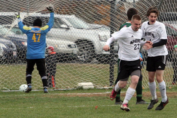 Fort Kent goalkeeper Reece Pelletier (left) retrieves the ball while Houlton's Pat Howe (center) celebrates with teammate Abe Lorom after Howe scored the first goal in their Class C North quarterfinal soccer game on Tuesday in Houlton.