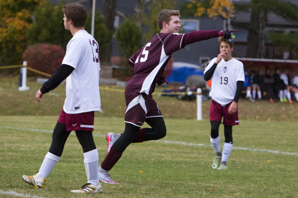 George Stevens Academy's Taylor Schildroth (center) celebrates after scoring against Orono during their Class C North quarterfinal soccer game on Tuesday in Orono.