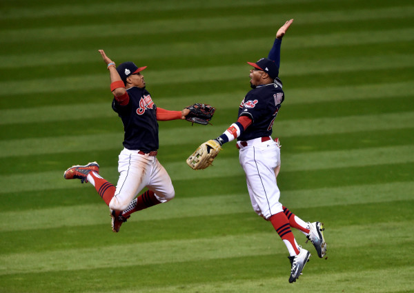 Cleveland Indians shortstop Francisco Lindor (12) celebrates with center fielder Rajai Davis (20) after defeating the Chicago Cubs in game one of the 2016 World Series at Progressive Field.