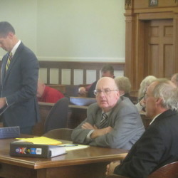 Attorney Walter McKee (left) and his clients former South Thomaston Fire Chief Wayne Brown (center) and former firefighter Colin Grierson, await the start of a civil trial brought by the town against Brown and Grierson for the return of nearly $15,000.