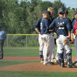 Coffee News Manager David Morris (right) meets with his pitcher and infielders during a turbulent eighth inning of the American Legion baseball state championship game at Wainwright Recreation Complex in South Portland in this August 2015 file photo.