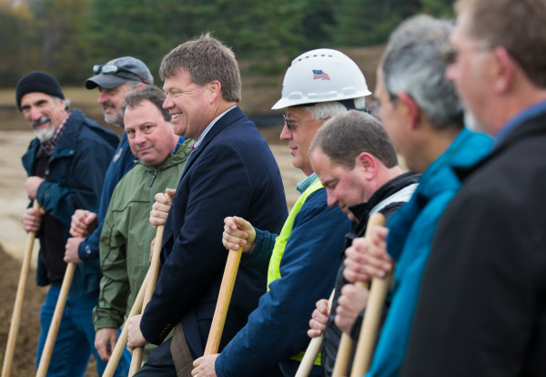 Municipal Review Committee Executive Director Greg Lounder (third from left), and Fiberight CEO Craig Stuart-Paul (center) stand among members of various companies involved in the development of the Fiberight municipal solid waste and recycling facility during the facility's groundbreaking ceremony on Wednesday in Hampden.