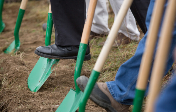 Shovels dig into the dirt for the Fiberight municipal solid waste and recycling facility during a groundbreaking ceremony on Wednesday in Hampden.