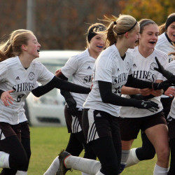 Members of the Houlton girls soccer team celebrate after Kolleen Bouchard scored the first goal of her two goals during their Class C North quarterfinal soccer game against Fort Kent on Wednesday afternoon in Houlton.