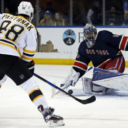 New York Rangers goalie Henrik Lundqvist (30) makes a save against Boston Bruins right wing David Pastrnak (88) during the third period at Madison Square Garden.