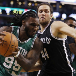 Boston Celtics forward Jae Crowder (99) drives the ball against Brooklyn Nets guard Bojan Bogdanovic (44) in the first quarter at TD Garden. The Celtics defeated the Brooklyn Nets 122-117.